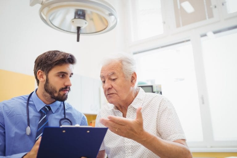 Patient consulting with a doctor in the hospital